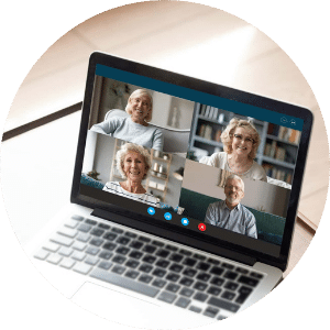 older people video chatting on a laptop